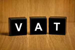 VAT or value added tax text on black block