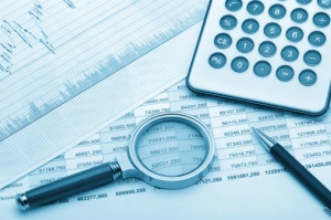 The calculator,loupe and financial report blue tone